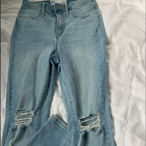 Ripped knee skinny jeans from tillys